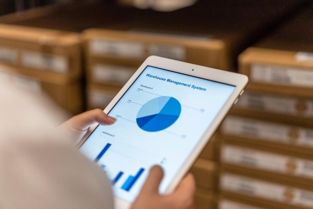 Employee managing warehouse forecasts on tablet