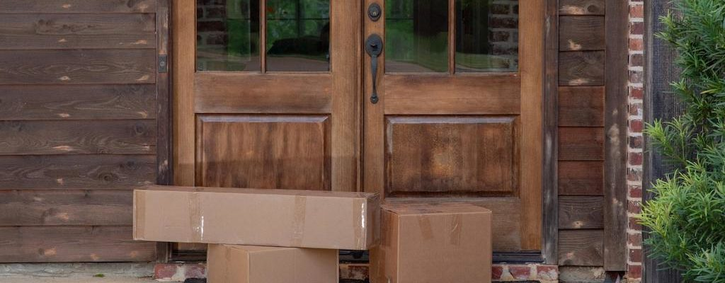 Cardboard boxes outside the front door of a house
