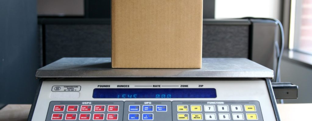 A package is weighed on a scale to determine shipping costs.